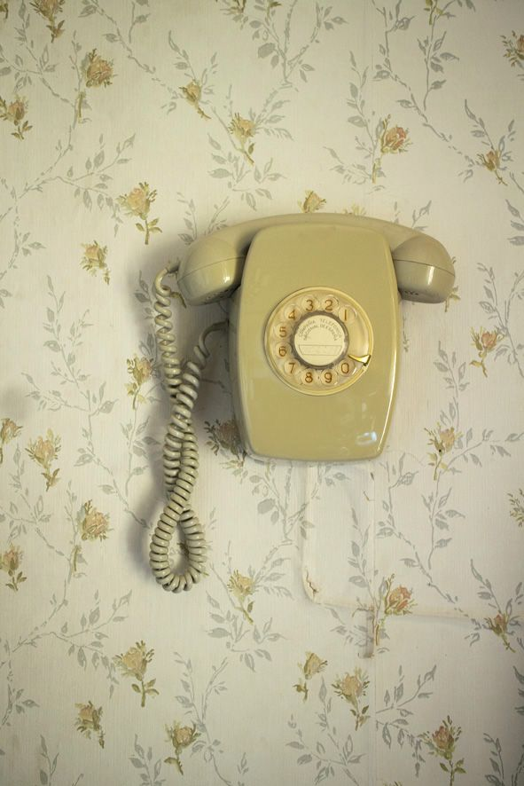 Mounted vintage wall phones look great on matching wallpaper. #interior #vintage #home #design