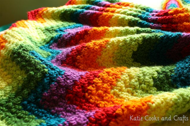 Rumpled Ripple Rainbow Baby Blanket, free pattern by Katie of Katie Cooks and Crafts. Soft & squishy stitch pattern of alternating DC & SC makes a nice closed fabric with no holes. List of yarns & colors, plus link to video tutorial also given.  . . . .   ღTrish W ~ http://www.pinterest.com/trishw/  . . . .   #crochet #afghan #throw