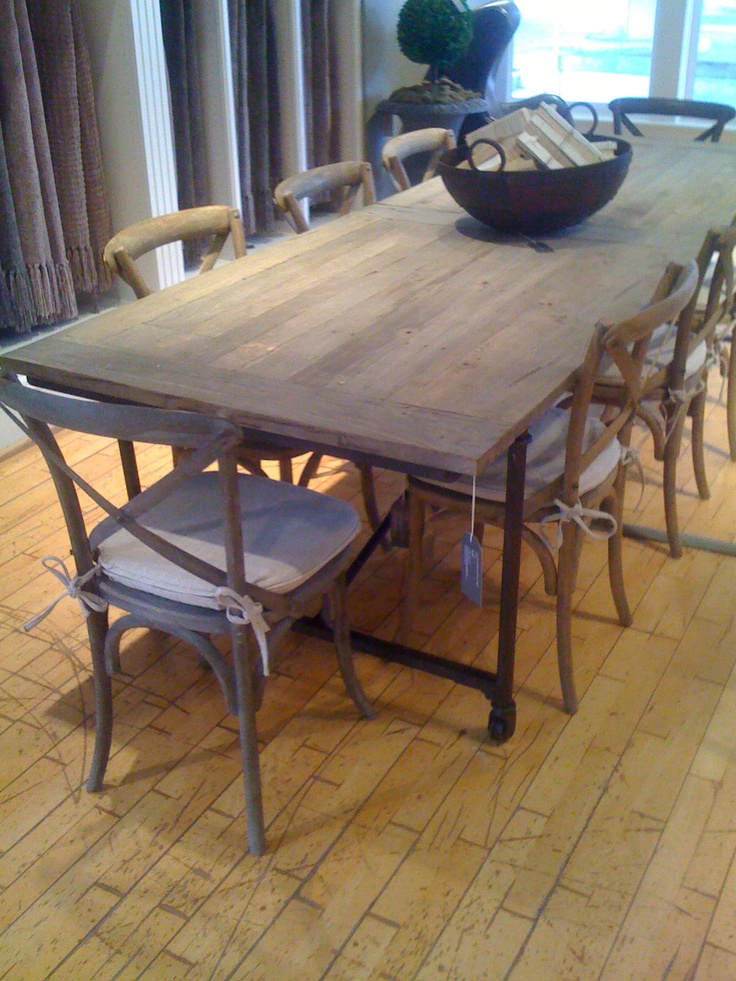 Restoration Hardware Table Made From A Reclaimed Door With Metal Legs On Casters