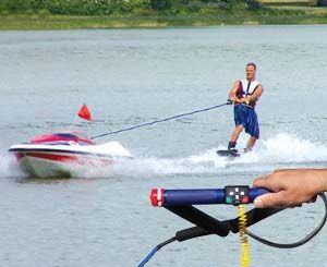 Self Controlled Tow Boat. Water ski anywhere and be in complete control with this unmanned water skiing boat that is controlled entirely by the skier. This unmanned skier boat holds up to six gallons of gas and automatically shuts off if the skier lets go of the handle.