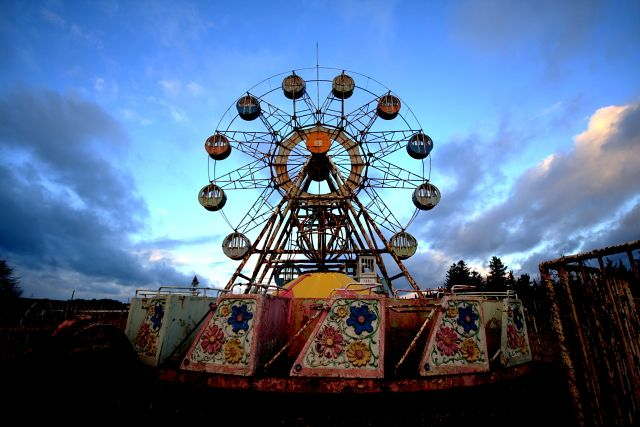 Ferris wheel in abandoned amusement park. Additional sources unknown.