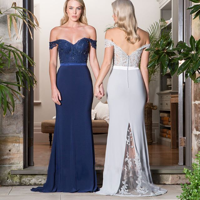Also available in berry and soft blush, this fitted, off the shoulder gown is the epitome of elegance. Lace work flows throughout the bodice of this gown and makes a show stopping surprise in the sheer inset at the back