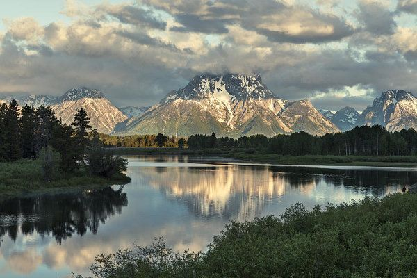 I took this photograph at Oxbow Bend in Grand Tetons National Park just as the sun was hitting the mountains. #photography ##homedecor #grandtetonsnationalpark