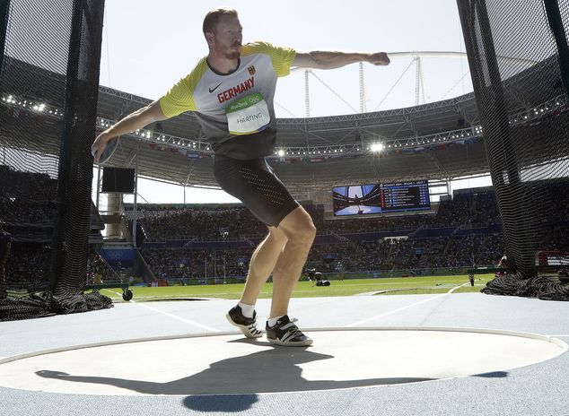 Germany's Christoph Harting throws the discus during the men's discus throw final at the athletics competitions of the 2016 Summer Olympics at the Olympic st...