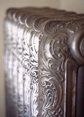 Beautiful hissing steam heat radiators...like pieces of art.