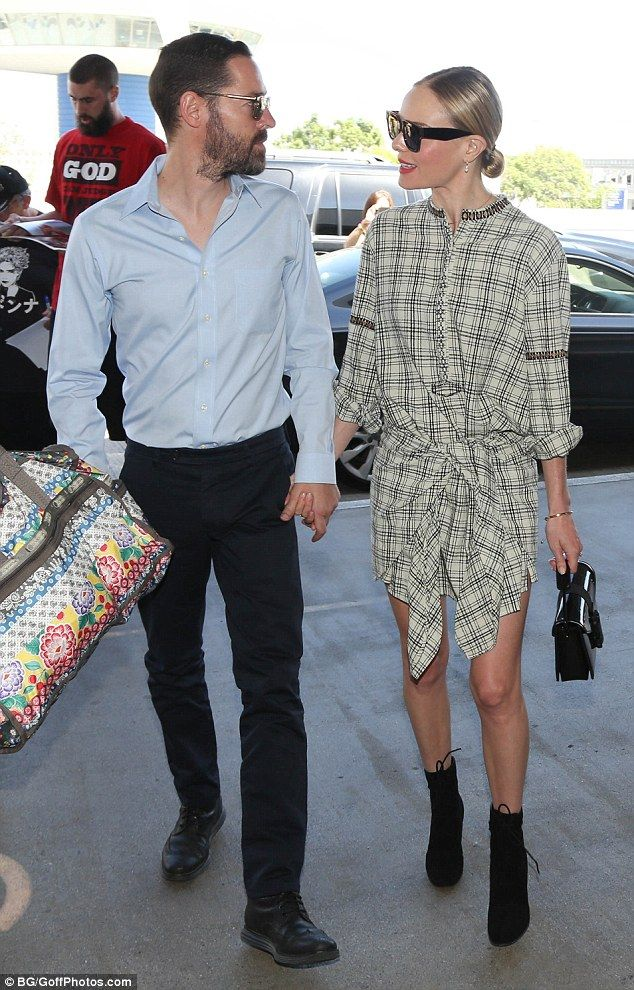 Off they go: Kate Bosworth (right) and husband Michael Polish were spotted at Los Angeles' LAX airport on Monday