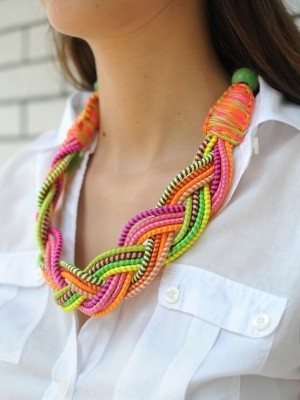 Take two of your fave summer trends (who doesn't love neon and braids?), and roll them into one show-stopper of an accessory