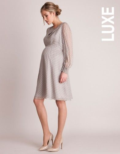 Champagne Silk Polka Dot Maternity Cocktail Dress | Seraphine Maternity | If you are wanting to go with a pattern, we suggest a minimal one like this polka dot maternity dress by Seraphine! Love the styling Seraphine's creative team used for this dress with the updo and nude pumps!