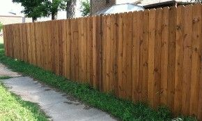 I really love this fence. I don't often see a wooden fence that isn't painted. I like it though because then you can see the natural beauty of the wood. It's gorgeous!