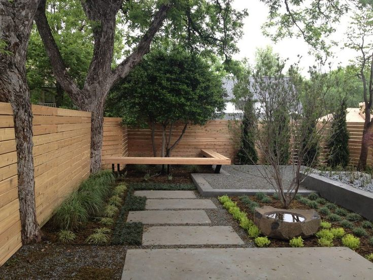 contemporary backyard landscape with bench seat indoor stair and step lights
