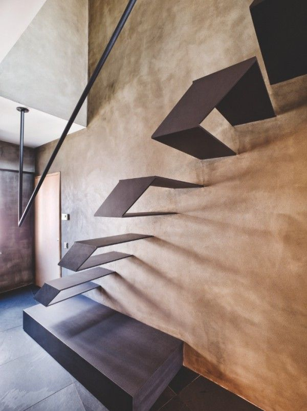 Karakoy Loft Uses Rich Wood Features and Creative Industrial Elements - The minimalist industrial-style staircase is perhaps one of the most captivating features of this modern loft.