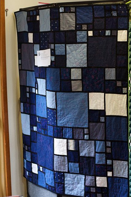 Denim quilt. Great use of different-sized squares.