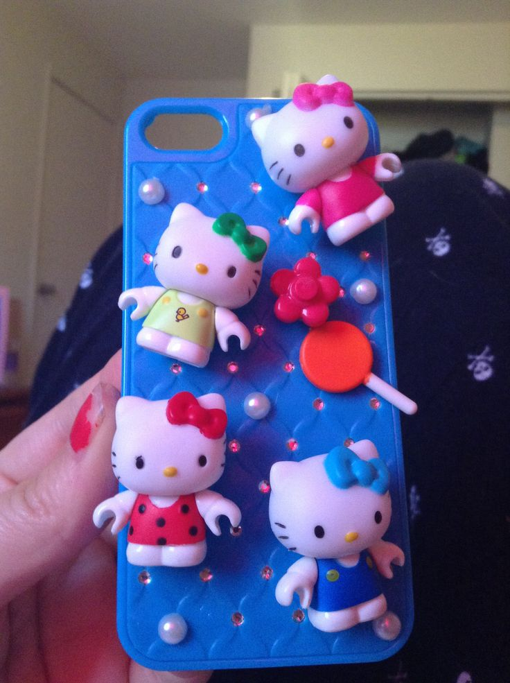 Hello kitty iphone 5 Case The phone case: Dollarama Hello kittys and charms: lego hello kitty sets from Dollarama Pearls: Dollarama Super Krazy glue: Dollarama How i made it: glued the hello kittys by their heads and glued down the charms and glued down a few pearls! DONE!