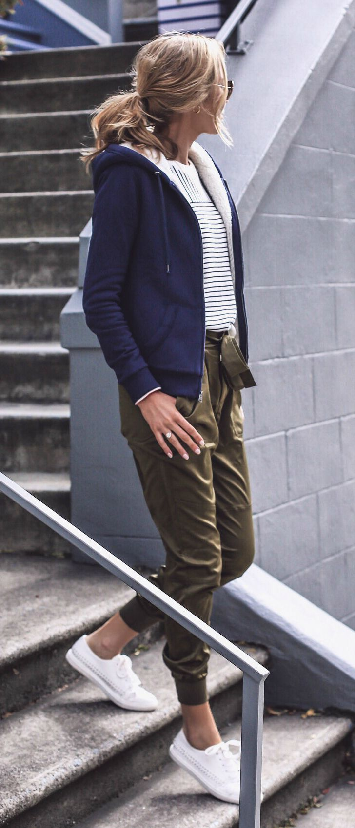 olive green satin joggers, white sneakers, mixed stripe sweater, fleece-lined navy hoodie #athleisure #fallstyle