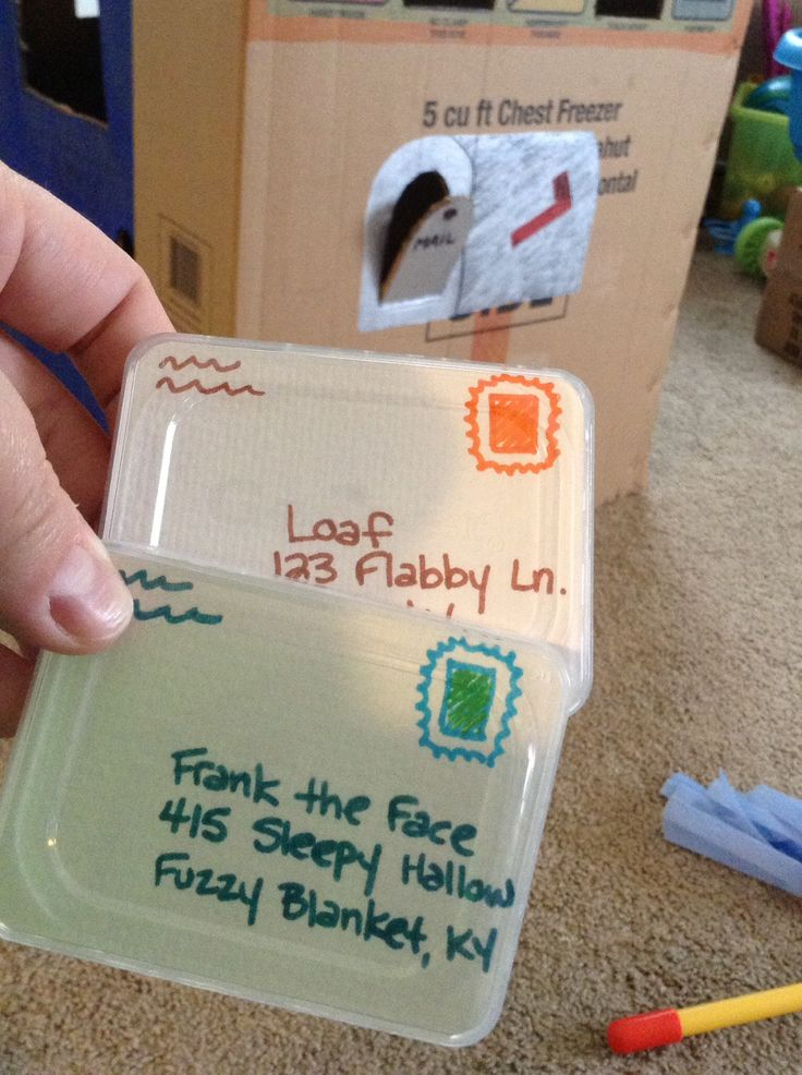 """We used plastic Gerber lids and paper to make """"mail"""" for our box turned playhouse.  My son loves putting them in the mailbox.  We also had fun making up addresses for our cats."""