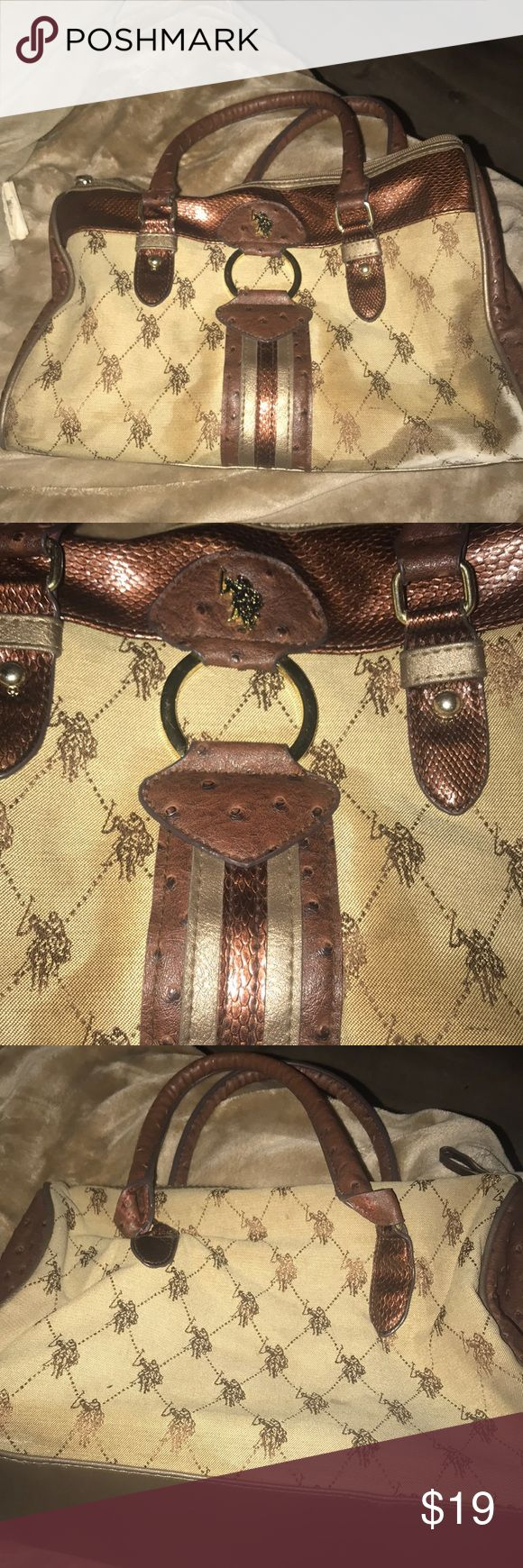 US Polo tan and brown hand bag classy and stylish Straight from NYC, rock this handbag to work or a party. Regardless you will be looking fresh and awesome U.S. Polo Assn. Bags Totes