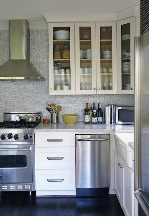 Gorgeous kitchen with glass-front upper cabinets and white ...