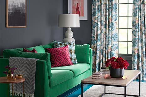 Charcoal + Emerald + Teal Dark charcoal walls set a rich, sophisticated tone in this living room. Intense jewel tones, including emerald, teal, and berry, brighten the look. Watch and see the secrets to successfully pulling off a dark wall color.