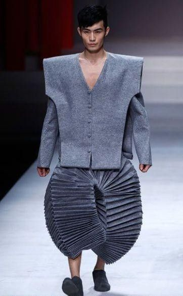 This outfit has such weird proportions that it is hard to imagine wearing it seriously.  More weird fashions on the runway: Would you wear them?  http://attireclub.org/2014/09/26/strange-fashion/  #fashion #clothes #menswear