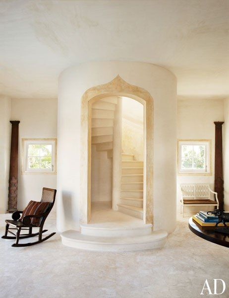 Extraordinary Staircases  Inspired by Greek temples and French manor houses, decorator Genevieve Faure conceived a peaceful oceanfront estate for a European couple in the Dominican Republic. An enclosed spiral staircase in the pool tower anchors the space.
