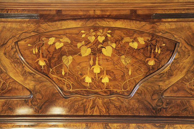 A Waddington upright piano for sale with an Art Nouveau style, walnut case. Cabinet features inlaid panels of fuchsias with sinuous tendrils and carvings of foliage and flowers at Besbrode Pianos