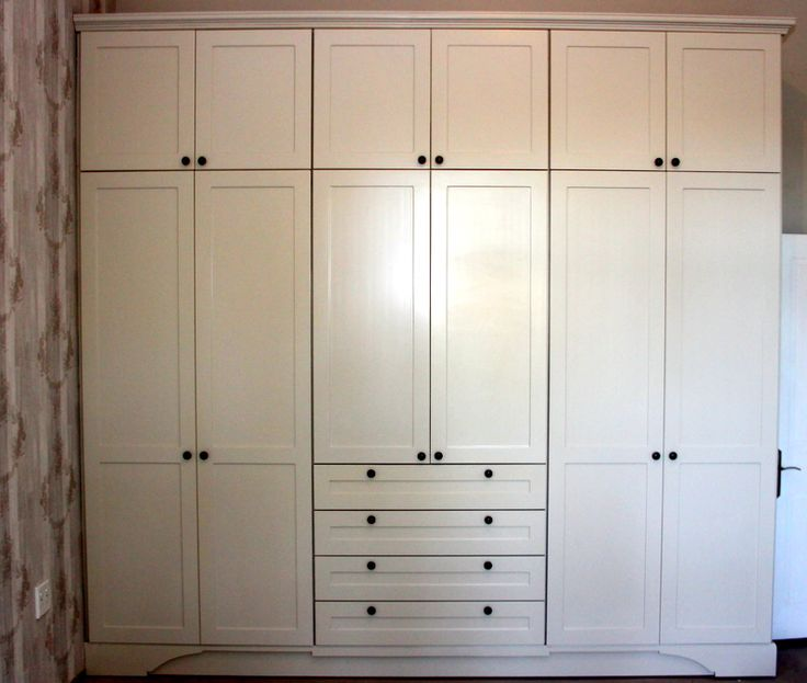 shaker style french inspired wardrobe. custom designed mold and kickplate. satin matt deco finish.