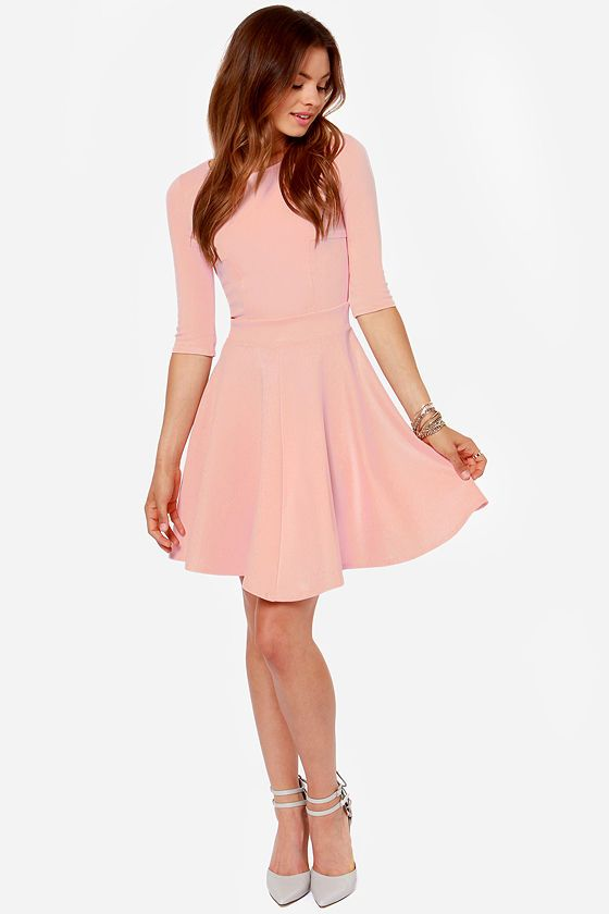 "Lulus Exclusive! The Just a Twirl Light Pink Dress wants you to stop standing still and start spinning! Stretchy knit is thick enough to wear on a chilly day as it hugs your curves down half sleeves and a fitted bodice with a rounded neckline and unique seam details. A banded waist is just the beginning of a full skirt that flares to twirl-worthy perfection. Hidden back zipper. Unlined. Model is 5'9"" and is wearing a size small. 65% Rayon, 30% Nylon, 5% Spandex. Hand Wash Cold or Dry Clean."