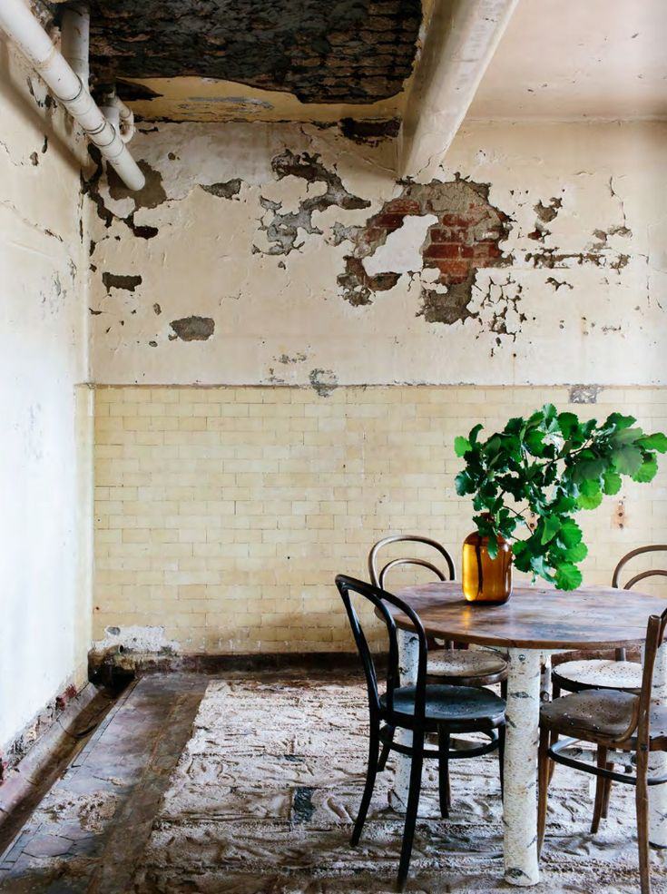 vintage dining room with rough plaster walls