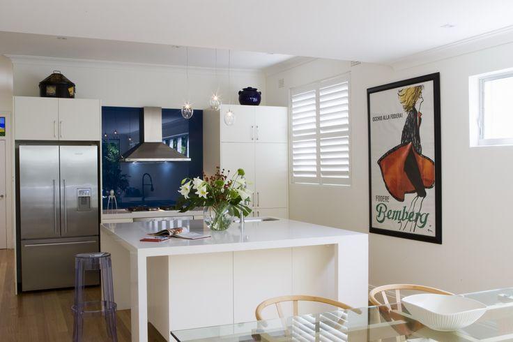 Kitchen with large square island. Brooke Aitken Design.