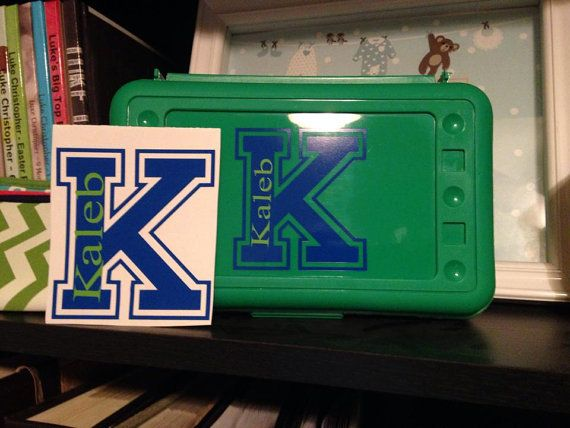 Personalized pencil box with matching decal. $8.50.  https://www.etsy.com/listing/201257339/personalized-varsity-style-pencil-box?