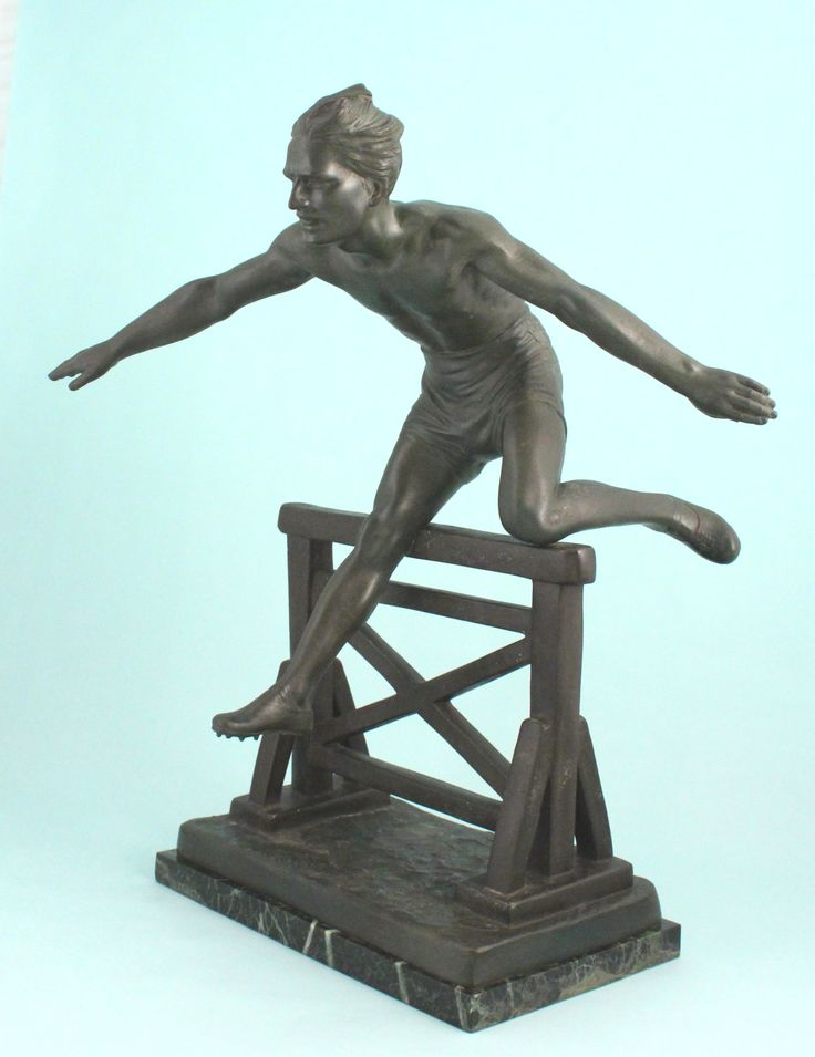 """Patinated metal figure of a hurdler by the famous Art- Deco-era sculptor, Demetre Chiparus (born 1886 in Romania, died 1947 in France). The figure with outstretched arms jumps above, as he clears the hurdle beneath. Signed D.H. Chiparus upon the naturalistic ground, with foundry seal upon back edge. The figure rests on a variegated black and white marble base. France circa 1930. 11 1/2"""" W., 6 3/4"""" D., 18 1/2"""" H. Offered by Cherub Antiques Gallery: http://www.cherubantiquesgallery.com/"""