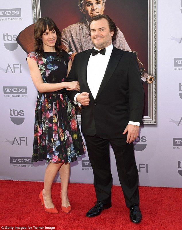 The look of love: Artist Tanya Haden gazed lovingly at her husband, Jack Black, as he struck a smug pose