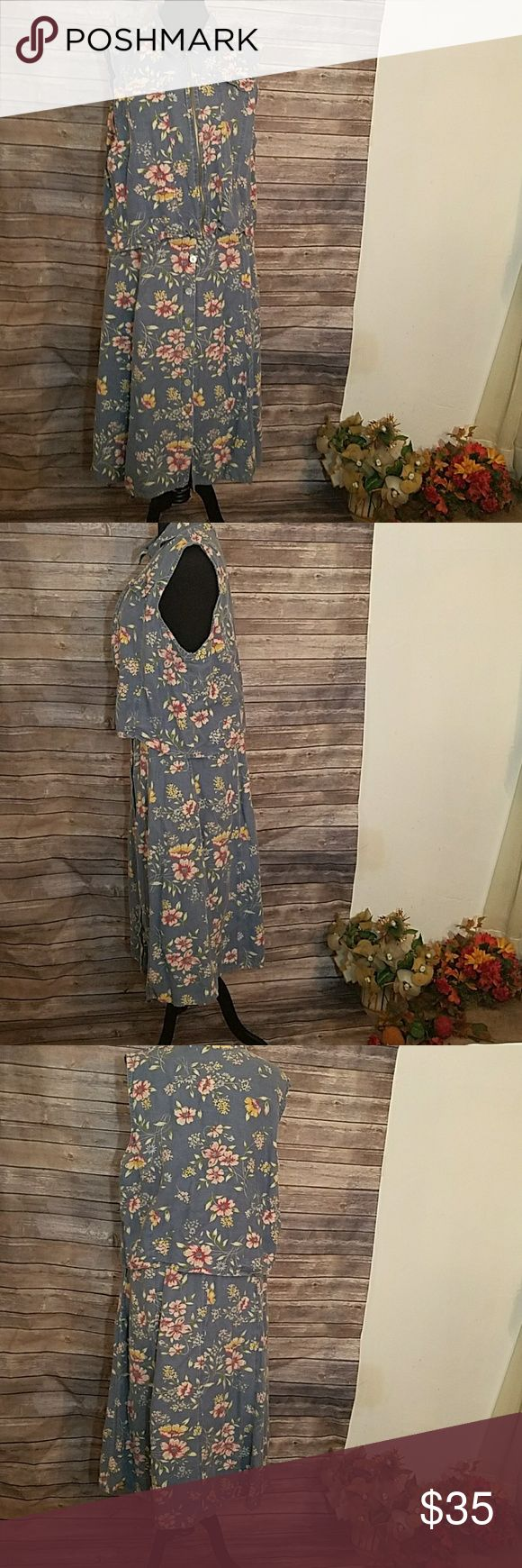 Capacity Woman 2 piece Denim Floral Skirt Set Vintage Floral Print Denim Vest with Matching Denim Skirt. The Skirt has back elastic waist. Skirt has 9 buttons in the front. The vest has a front zipper and two mock pockets on the front. Capacity Woman Skirts