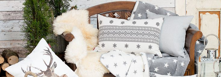 Scandinavian style cushion from the Christmas collection and stag print cushion cover for a simple and comfortable Nordic interior.
