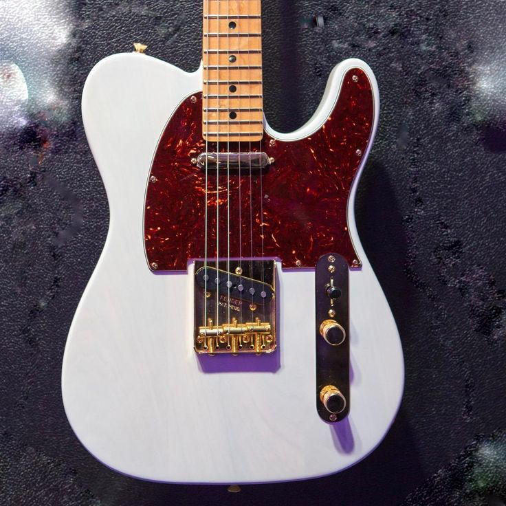 """Introducing the Magnificent 7 Limited Edition Fender Select Lite Ash Telecaster. Lightweight ash body, each instrument weighs 7 lbs. or less . All-gold hardware, a tortoiseshell pickguard and White Blonde lacquer finish. Includes a """"Special Edition"""" ingot inlaid in the rear of the headstock. Find one at your local dealer."""
