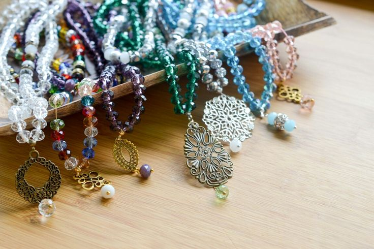 Crystal Tasbihs with a variety of pendants.