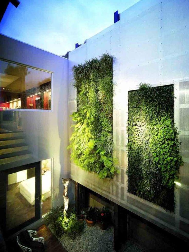 maison de design moderne avec mur végétal extérieur super