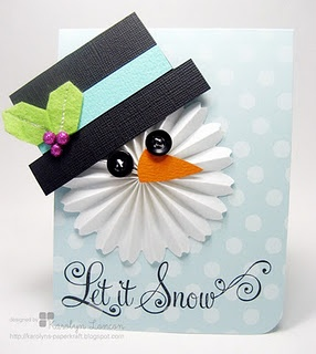 moxie fab paper crafts floral medallion (or rosette) as applied to a snowman image, but what really gets me is the whimsical theme that is carried throughout the card. The light-colored polka dot background that is reminiscent of snow, the sweet little hat and face on the snowman, and the piece de resistance--the swirly font in the sentiment. Kudos to you Karolyn for rocking the style in this