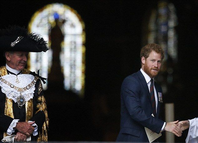 Prince Harry,  pictured right, and the Lord Mayor of London, Alan Yarrow, left, leave St Paul's Cathedral