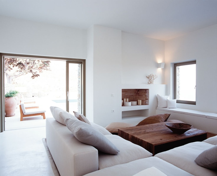 window, doors & sofa.  clean, smooth lines. contemporary white living room //