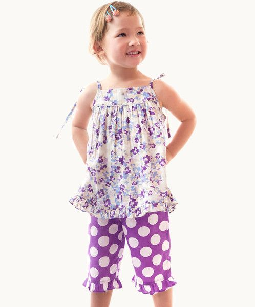 If only all clothes were this much fun! The pretty Pansy print summer top has spaghetti tie straps and a hem ruffle, and is complimented by the 3/4 length Lolly lilac polka dot pants. The pants have a cute ruffle hem to match the top. Super sweet! #fairtrade #kids #clothes #australia