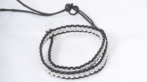 The shorter option of the handmade bracelet is made of leather and 100% silver, which is minimal in its design, but still cool enough to stand out.