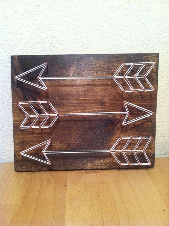 Customize your own arrow string art on a 7x9 solid wood board. Wood stain, string color and nails can be customized. If no customization is