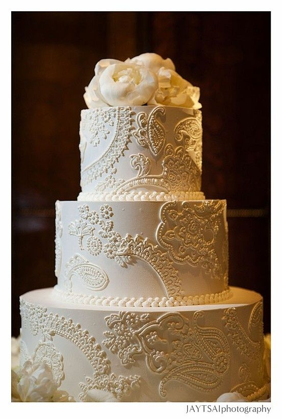 Beautiful white on white mehndi design cake