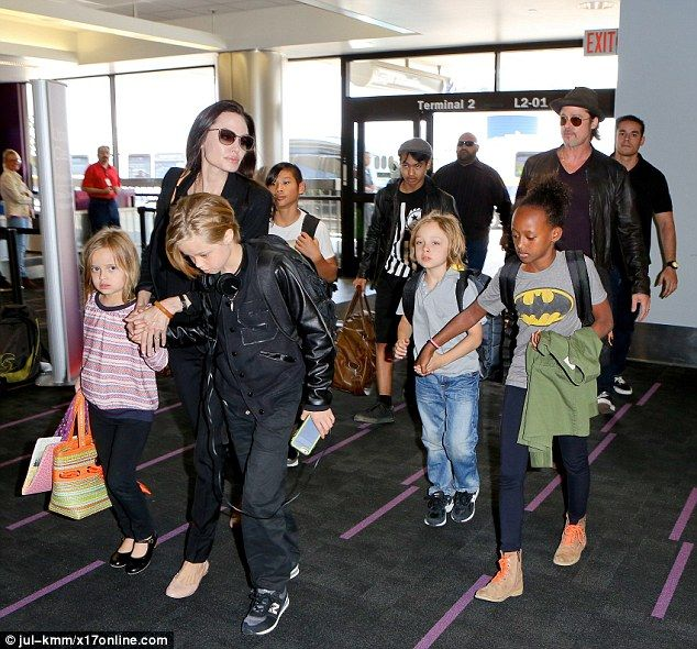 The gang's all here: All six of Brad and Angelina's children were spotted at the international airport