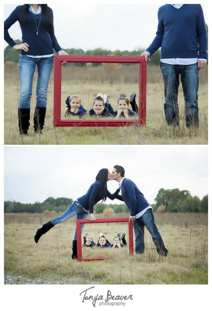 Kids laying in a field while the parents hold a red picture frame kids covering their eyes while their parents kiss so cute Live Oak family photos - Live Oak Photographer - Jacksonville Photographer - Tonya Beaver Photography022