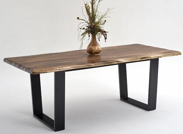 The center of most homes is the dining room table. Dinner is ate there, homework is done on it, and let's not get started on how many projects get thrown on it the night before it's due at school. This astounding contemporary rustic dining table is crafted from solid black walnut from northern Michigan. Other
