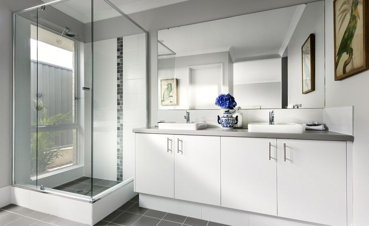 Resort style ensuite with 'His' and 'Her' vanity basins and separate WC