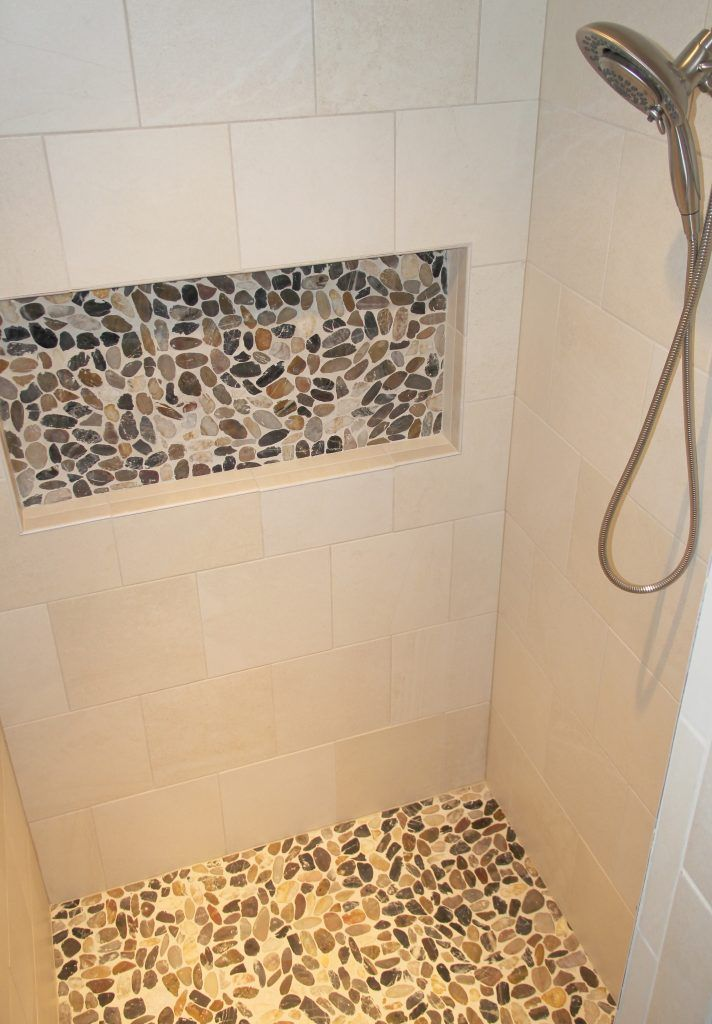 Porcelain Tile Cream Shower Walls With Accent Pebble Niche And Shower Floor Pebble Shower Floor Shower Wall Tile Shower Wall