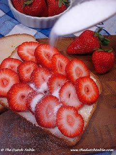 """Zomerkoningkjes, """"Summr Kings,"""" is the Dutch nickname for strawberries. Served in early summer on a slice of bread 'n buttr...with sugar sprinkled on! From: The Dutch Table"""